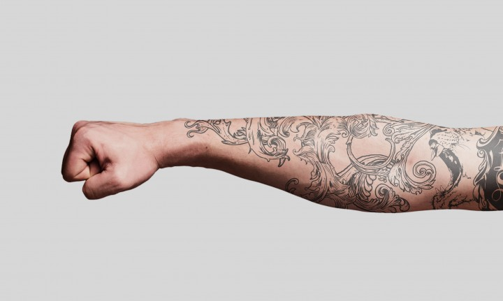 Clenched fist tattoo